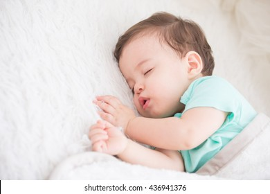 Newborn cute baby sleeping. Closeup portrait, caucasian child
