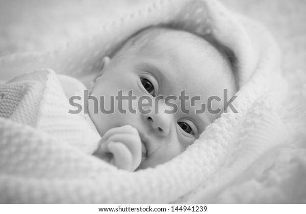 newborn with Down syndrome is quiet and looks