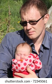 newborn girl with her father