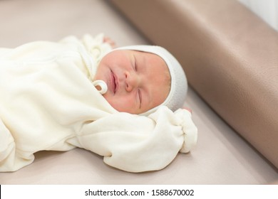newborn girl sleeping on furs