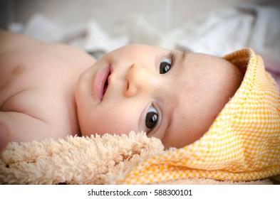 newborn hood eyes closeup gaze face portrait