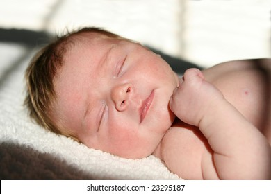 newborn infant laying in the sun