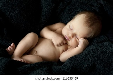 newborn nice baby on a black background