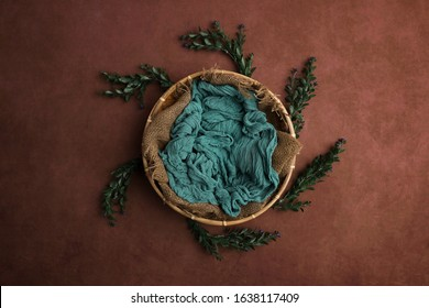 Newborn photography digital background prop. wicker basket on a painted canvas.