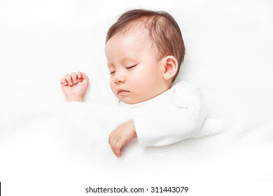 Newborn sleeping on the white bed, New family and baby protection concept