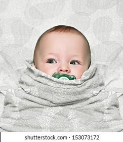 newborn swaddling with dummies