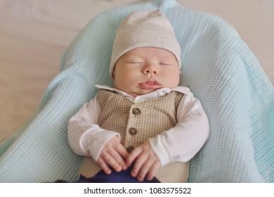 newborn tiny gentleman wearing little shirt and vest