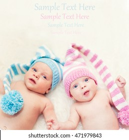 Newborn twins boy and girl with copy space