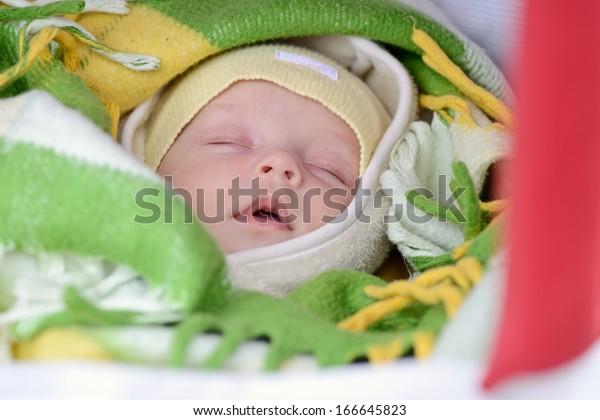 newborn in winter sleeping in the pram