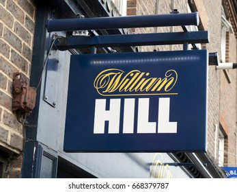 Newbury, Berkshire, England - June 16, 2017: William Hill bookmakers sign, company founded by William Hill in 1934 at a time when gambling was illegal in Britain