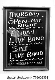 Newbury, Berkshire, England - November 16, 2017: Monochrome live band and open mic night advertising blackboard outside public house