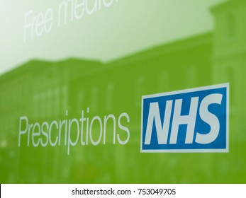 Newbury, Berkshire, England - November 3, 2017: NHS, National Health Service prescriptions sign in pharmacy shop window