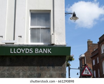 Newbury, Northbrook Street, Berkshire, England - June 16, 2017: Lloyds bank sign over local branch office, British retail and commercial bank, originally founded in Birmingham in 1765
