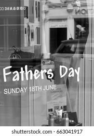 Newbury, Northbrook Street, Berkshire, England - June 16, 2017: Monochrome Fathers Day shopfront window display