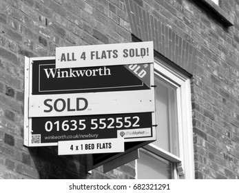 Newbury, Northbrook Street, Berkshire, England - June 16, 2017: Monochrome Estate Agent sign above properties showing all four residential flats sold