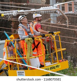 Newbury Station, Berkshire UK. August 2018.  Engineers working on the electrification of the railway line at Newbury