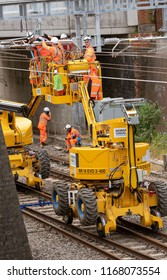 Newbury Station, Berkshire UK. August 2018. Engineers working on the electrification of the railway line at Newbury Using a road and rail access platform piece of equipment.