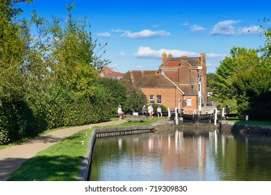 Newbury, UK - August 27 2017:  Peope relaxing by a lock on the canal in Newbury on a summer day