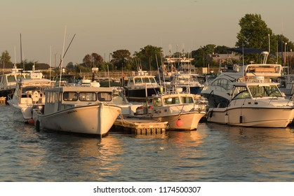 Newburyport, Mass./USA - Sept. 3, 2018: Boats docked in the Newburyport harbor at sunset.