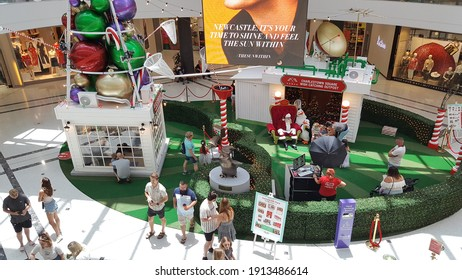 Newcastle, Australia - Dec 2020: Selective focus view of people at the yearly traditional Santa photo booth at centre court, Charlestown Square
