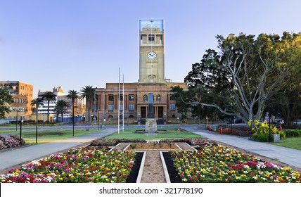 newcastle Australia ?own hall facade from park with blooming flowers during reconstruction of clock tower