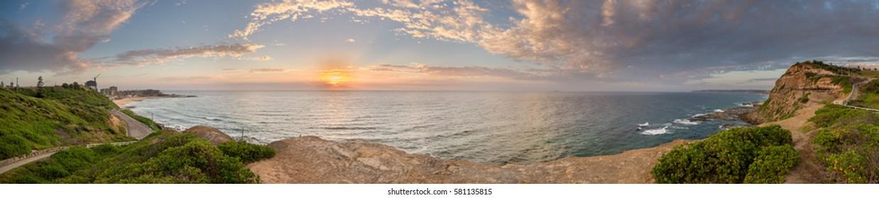 Newcastle Beach panorama at sunrise.
