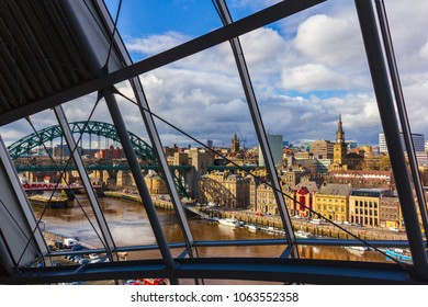 Newcastle city Skyline through Sage Gateshead windows with River Tyne, Tyne Bridge  and other buildings at Newcastle Quayside in view