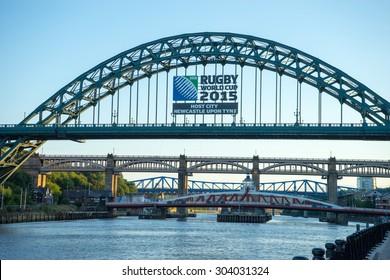 NEWCASTLE, ENGLAND - AUGUST 6: Tyne Bridge, Newcastle/Gateshead. A bridge that crosses the Tyne, taken on August 6th, 2015 at Newcastle, England. Rugby World Cup 2015 ad is on Tyne Bridge.