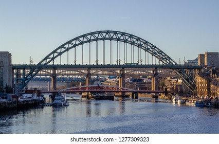 Newcastle, England. December 24, 2018. View Of The Arched Tyne Bride, Swing Bridge & High Level Bridge From The Quayside.