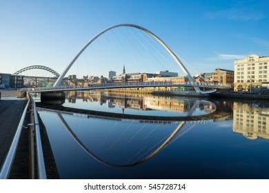 NEWCASTLE, ENGLAND - DECEMBER 29 2016: Gateshead Millennium Bridge with the Baltic Centre for Contemporary Art. The bridge spans the River Tyne in north east England.