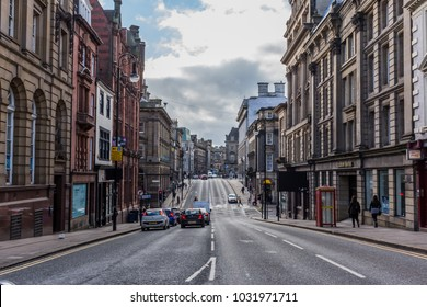 NEWCASTLE, ENGLAND - February 17, 2018: City center with bars and shopping streets in Newcastle, Great Britain. Found in the second century it's one of the most popular destinations on the island.