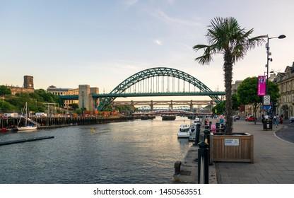 Newcastle, England - June 27 2018: Newcastle upon Tyne skyline, Gateshead with the Tyne Bridge over River Tyne, Tyne and Wear, Tyneside, England, United Kingdom, Europe