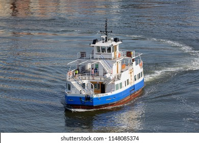 Newcastle, England - May 18 2018: Small ferry with passengers crossing river Tyne in Newcastle harbor