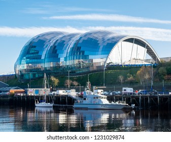 Newcastle, England. November 15. 2018. View of the Sage Gateshead building on the quayside with Boats docked by the river.