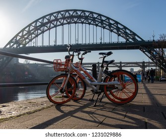 Newcastle, England. November 15. 2018. View of Mobike bicycles rent by app by the quayside with the tyne bridge in the horizon.