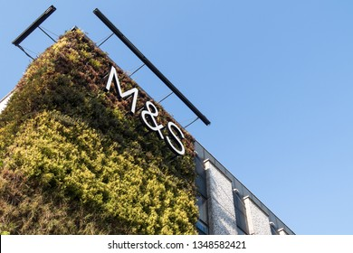 Newcastle / Great Britain - February 27, 2019: Exterior of Marks and Spencers M & S building with living green wall.  Showing company logo, sign, signage and branding.