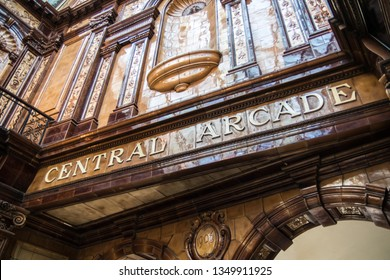 Newcastle / Great Britain - February 27, 2019: Entrance to Edwardian Central Arcade shopping centre mall showing sign and date with tiled facade