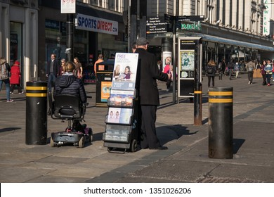 Newcastle / Great Britain - February 27, 2019:  Jehovah's Witnesses on the street.  Street preaching, missionary, Christianity