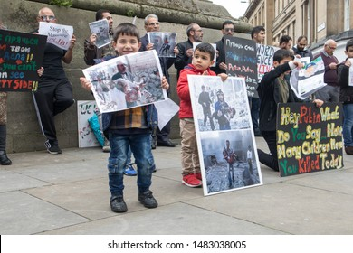 Newcastle / Great Britain - June 15, 2019 : Anti war in Syria protest by men women and children holding banners and placards.  Anti Assad, Anti Putin.  Peaceful protest.