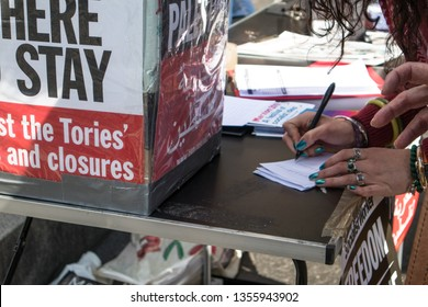 Newcastle / Great Britain - March 30, 2019: Person signing petition at the Free Palestine Rally held by the Palestine Solidarity Campaign organised to coincide with the Gaza Return March and Land Day.