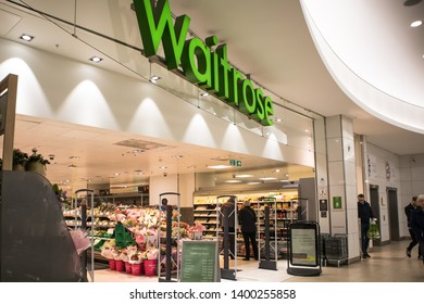 Newcastle / Great Britain - March 30, 2019 : Entrance to Waitrose Grocery Supermarket shop in modern shopping mall centre