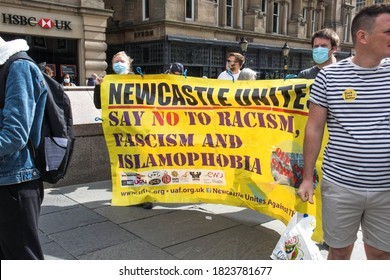 Newcastle / Great Britain - September 5, 2020 : Anti-racism, fascism and islamophobia banner being help by protesters at public rally demonstration