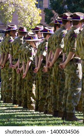 Newcastle, New South Wales / Australia - April 25 2012: Anzac Day remembrance.  Australian Army soldiers at ease waiting for the Anzac Day march to commence.  Civic Park, Newcastle.