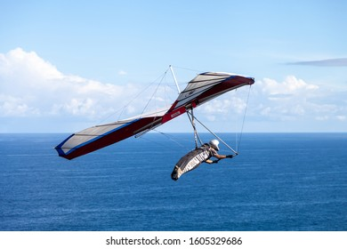 Newcastle, New South Wales / Australia - March 1, 2016: Hang-glider over the ocean, against a blue sky at Newcastle, New South Wales Australia