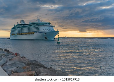 Newcastle, NSW / Australia - February 16  2019: Royal Caribbean 'Explorer of the Seas' cruising into Newcastle during Sunrise viewed from Stockton Beach, Stockton in Newcastle, NSW, Australia.