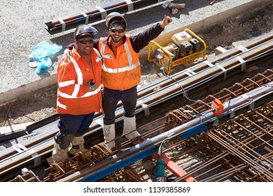 NEWCASTLE, NSW, AUSTRALIA - JULY 19, 2018: Two construction workers taking a break after heavy work on the site of the city's light rail (tram) project.