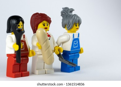 NEWCASTLE, NSW/ AUSTRALIA - March 23 2019: Close up image of three female lego minifigures posing as tradespeople against a white background