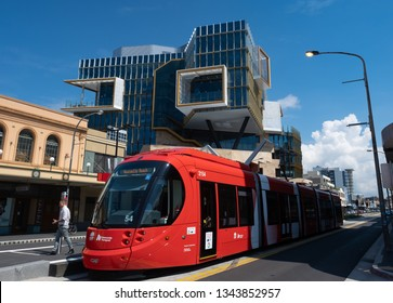 NEWCASTLE, NSW/AUSTRALIA - MARCH 19 2019: Newcastle tram, stopping in front of the new Newcastle University campus in the city, as part of the city's urban renewal and development program