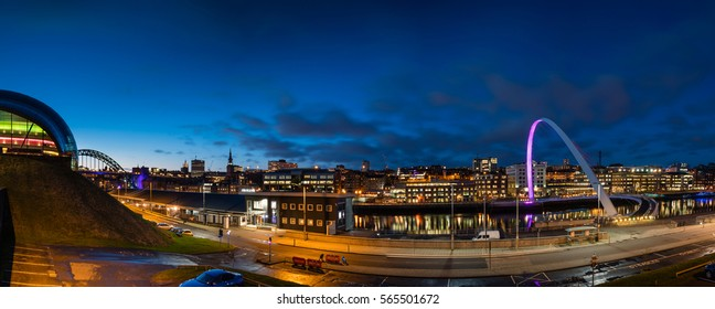 Newcastle Quayside Panorama at Night / The Quayside at Newcastle on the banks of the River Tyne, with its famous bridges and Newcastle upon Tyne skyline beyond, viewed at night