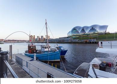 Newcastle Quayside with Sage Gateshead concert hall, Gateshead Millenium Bridge and Boat in sight